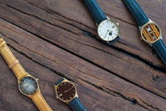 Wrist watches on a wooden table Royalty Free Stock Image