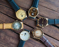 Wrist watches on a wooden table. Vintage Wrist watches on a wooden table stock photography