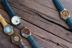 Wrist watches on a wooden table. Vintage Wrist watches on a wooden table Stock Photo