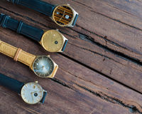 Wrist watches on a wooden table. Vintage Wrist watches on a wooden table Royalty Free Stock Photography