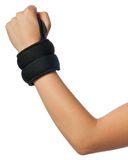 Wrist Weights. Vertical isolated photo of a girl wrist with small wrist weight. These weights are used for sports injury reasons Royalty Free Stock Photo
