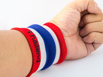The wristband have colourful on wrist human for cheer. The wristband have colourful made of a towel-like terrycloth material. These are usually used to wipe Royalty Free Stock Photo