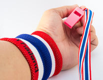 The wristband have colourful on wrist human for cheer. The wristband have colourful made of a towel-like terrycloth material. These are usually used to wipe Royalty Free Stock Photography