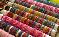 Wristband market stall. Closeup of colorful leather wristbands on a market stall stock images