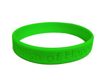 Wristband vert de silicones Photos stock