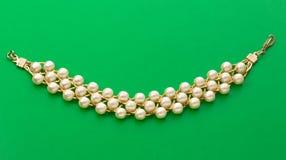 Wristband with white beads Stock Photos