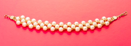 Wristband with white beads Royalty Free Stock Photo