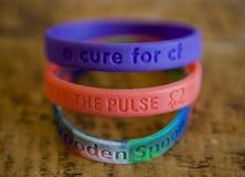 Wristbands de la caridad Imagenes de archivo