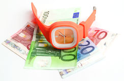 Wristlet watch with banknotes. 10, 20 and 100 euro on a white backgound Royalty Free Stock Image