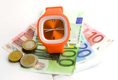 Wristlet watch with banknotes and coins. Wristlet watch with banknotes 10, 20 and 100 euro on a white backgound Stock Image