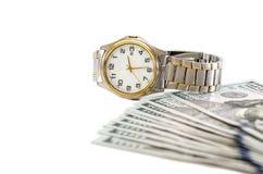 Wristwatch με τα δολάρια σε ένα άσπρο υπόβαθρο στοκ φωτογραφίες