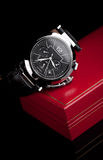 Wristwatch. And red case on a black background Royalty Free Stock Photo