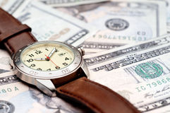 A wristwatch on American currency Stock Photo