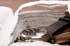 Wristwatch in book safe Royalty Free Stock Photos
