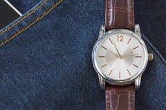 Wristwatch on denim jeans pocket Stock Images