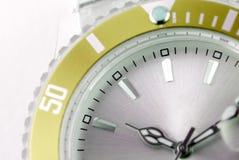 Wristwatch detail. Closeup of a modern silver and green wristwatch Royalty Free Stock Photos