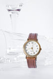 Wristwatch and glass Royalty Free Stock Photo