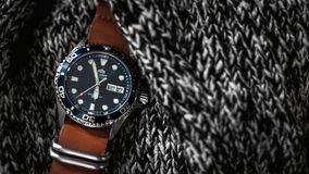 Wristwatch on knitted fabric