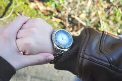 Wristwatch and leather coat Stock Image