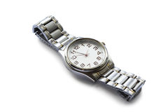 Wristwatch. Male metal wristwatch with round face on white background Stock Photos