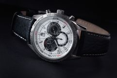 Wristwatch. Mens watch close-up on a dark background Royalty Free Stock Image