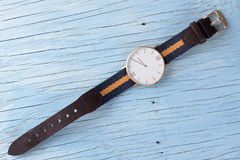 Wristwatch. On old wooden table Stock Photography