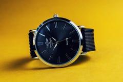 Wristwatch on orange Stock Photos