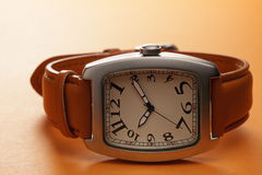 Wristwatch over brown Royalty Free Stock Image
