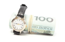 Wristwatch and roll of tied banknotes. White background Stock Photo