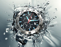 Wristwatch splashing into water Royalty Free Stock Image