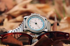 Wristwatch with sunglasses stock photo