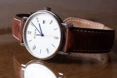 Wristwatch on tabletop Royalty Free Stock Photos