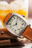 Wristwatch and wallet Stock Image