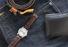 Wristwatch and wallet on denim jeans pocket Stock Photography