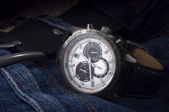 Wristwatch. Watches for men are on the jeans Stock Image