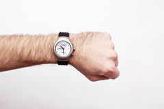 Wristwatch on a wrist. Isolated Stock Image