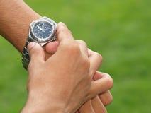 Wristwatch on wrist Royalty Free Stock Image