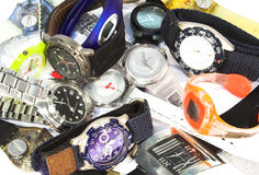 Wristwatches. Pile of various colourful wristwatches Royalty Free Stock Photo