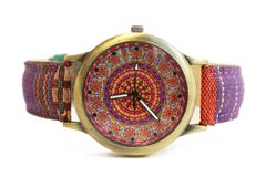 Wristwatches in hippie ethnic style on a white isolated background stock photo