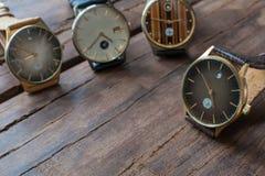 Wristwatches na drewnianym stole Zdjęcia Royalty Free