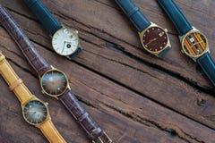 Wristwatches na drewnianym stole Zdjęcia Stock
