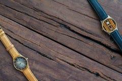 Wristwatches na drewnianym stole Obrazy Stock
