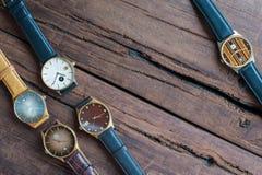 Wristwatches na drewnianym stole Zdjęcie Stock