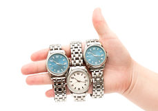 Wristwatches on women`s hand. Three wristwatches on women`s hand isolated on white background Royalty Free Stock Images