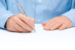 Write. Male hand with pen write something on white background stock image