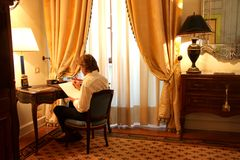 Write. A man write in a luxury hotel room Royalty Free Stock Photo