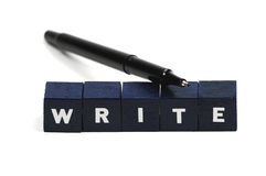 Write. A pen laying across the word write royalty free stock photography