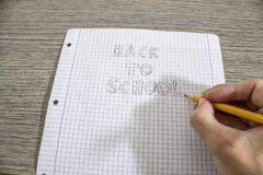 Write back to school handwritten on a paper. Composition stock image