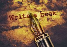 Write a book. Text Write a Book and a fountain pen on dark golden background royalty free stock images