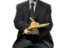 Write On The Clipboard. Business man write on the clipboard isolated over white background Royalty Free Stock Image